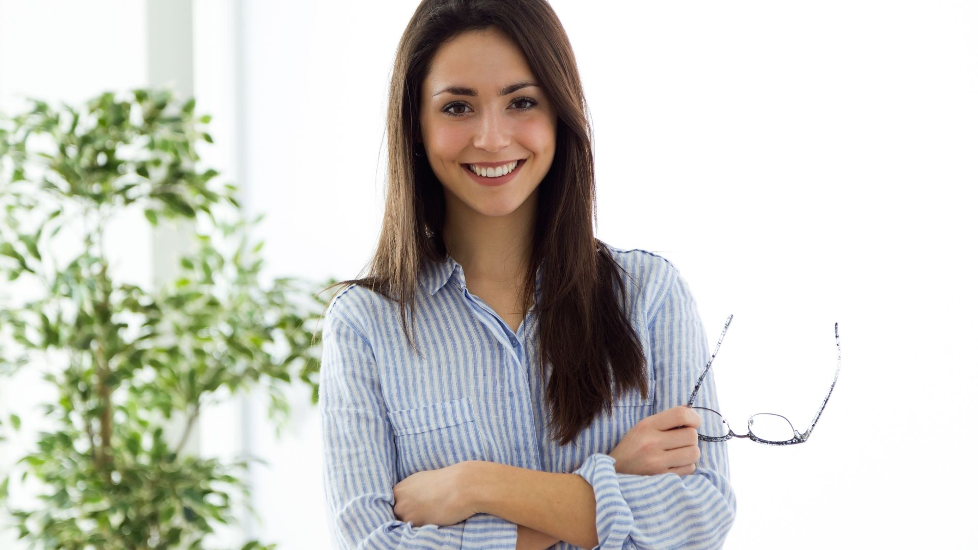 business woman holding glasses